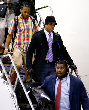 The Seahawks, including quarterback Russell Wilson, center, arrived in Newark on Sunday night.