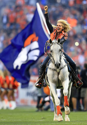 Ann Judge-Wegener rides Thunder before a Broncos game this season at Sports Authority Field.