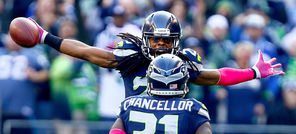 "Richard Sherman celebrates with Kam Chancellor after an Oct. 13 interception. ""When you know him, it's funny,"" Chancellor said of Sherman's controversial postgame interview."