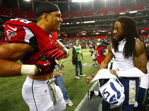 Richard Sherman exchanges jerseys with Atlanta Falcons tight end Tony Gonzalez, left, in a gesture of friendship after their game Nov. 10.