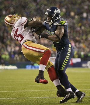 Seahawks safety Kam Chancellor lays out San Francisco 49ers tight end Vernon Davis during a game last season, earning an unnecessary roughness penalty.