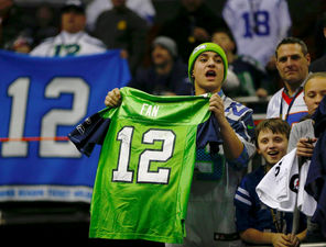 Seahawks fans show their spirit during Super Bowl XLVIII Media Day on Tuesday at the Prudential Center in Newark, N.J.
