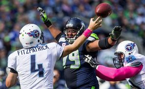 Tennessee Titans Ryan Fitzpatrick gets off a pass under heavy pressure by the Seahawks' Red Bryant in their October matchup. Bryant joined the team in 2008 during coach Mike Holmgren's final year.