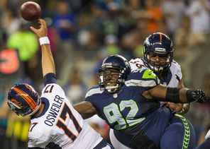 Seahawk Brandon Mebane, right, swoops in on backup Denver Broncos quarterback Brock Osweiler to finish off a sack for a 7-yard loss in their exhibition game. Mebane joined the team in 2007.