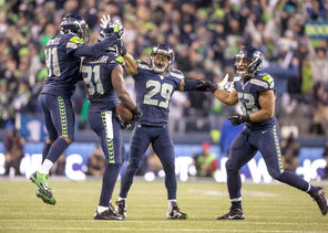 The Seahawks defense celebrated a lot this season, including this interception by  Kam Chancellor, second from left.