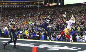 Richard Sherman, center, creates a game-saving interception when he tips a pass intended for 49ers receiver Michael Crabtree in the NFC title game. It was one of just three times Sherman was thrown at in the playoffs.