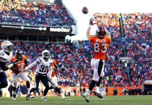 Wes Welker hauls in a touchdown pass against San Diego in a playoff win. The former New England star is just one of several players Peyton Manning likes to throw to.