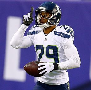 Readers select safety Earl Thomas as the defensive MVP, and Jenks agrees.