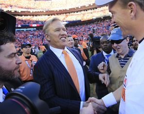 DENVER, CO - JANUARY 19: John Elway, executive vice president of football operations for the Denver Broncos, celebrates with Peyton Manning #18 after they defeated the New England Patriots 26 to 16 during the AFC Championship game at Sports Authority Field at Mile High on January 19, 2014 in Denver, Colorado. (Photo by Jamie Squire/Getty Images) -- 463736997