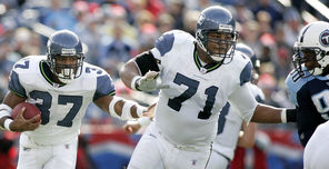 In December of 2005,  Walter Jones (71) leads the way for  Shaun Alexander who won the MVP that season as Seattle went to the Super Bowl.