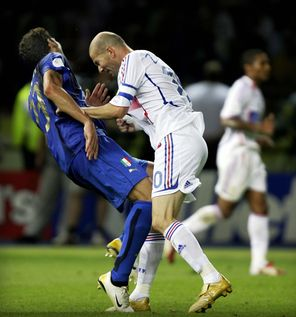 Some people just don't like you bad-mouthing  their sister, as France's Zinedine Zidane, right, clearly indicates to  Italy's Marco Materazzi.