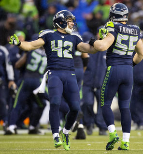 Seattle's Chris Maragos (42) celebrates another successful special-teams play with teammate  Heath Farwell. Maragos, with his speed and preparation, is a vital part of the Seahawks' success in special-teams play that has helped the team land a spot in the Super Bowl.