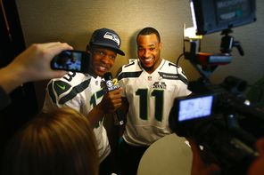 Seahawks receiver Phil Bates, left,  interviews teammate and fellow receiver Percy Harvin during a media availability session. <br/>
