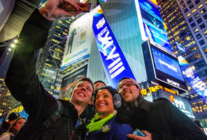A group of Seahawk fans take a self-picture while visiting Times Square. But tourist activities will come to a pause today as Super Bowl XLVIII has arrived.