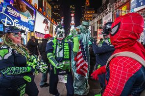 Seahawks fans, including Bruce McMillan (second from left), are in game-day form while walking the streets of New York City on Friday night.