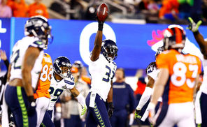 Seahawks safety Kam Chancellor (31) celebrates after intercepting a pass from Denver quarterback Peyton Manning.<br/>