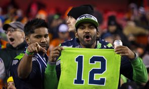 Seahawks fans attending the game in New Jersey display their 12th Man pride during second half.