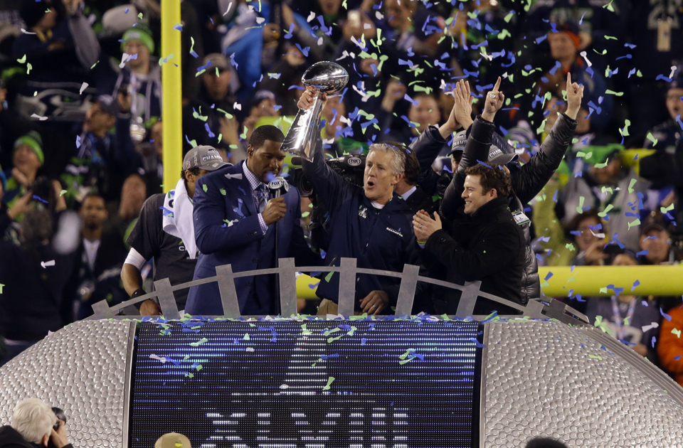 The Seattle Seahawks won their first Super Bowl in franchise history with a 43-8 victory over the Broncos at MetLife Stadium in New Jersey on Feb. 2. Seattle was lifted by a relentless defense that forced four turnovers and some big plays, including an 87-yard kickoff return by Percy Harvin. Above, coach Pete Carroll holds the Lombardi Trophy aloft as he and general manager John Schneider celebrate the Hawks' historic win.