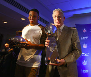 The Seahawks' Super Bowl MVP Malcolm Smith, left, and winning coach Pete Carroll pose with their NFL finery Monday. Carroll is holding the  Lombardi Trophy, which goes to the team that wins the  Super Bowl.