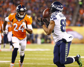 Doug Baldwin brings in a 37-yard pass from Russell Wilson before being brought down by Denver's Champ Bailey during the first quarter. Baldwin   led the Seahawks with five catches for 66 yards and a touchdown.