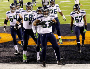 Super Bowl MVP Malcolm Smith (53), celebrating his second-quarter TD, is one of several young Seahawks under contract at a bargain price.