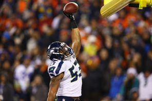 Seahawks linebacker Malcolm Smith  celebrates after his pick-six in the Super Bowl against the Denver Broncos, which helped earn him the MVP trophy.