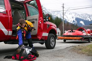 Rescue worker Danielle Rivera get her equipment ready before heading out from Darrington.