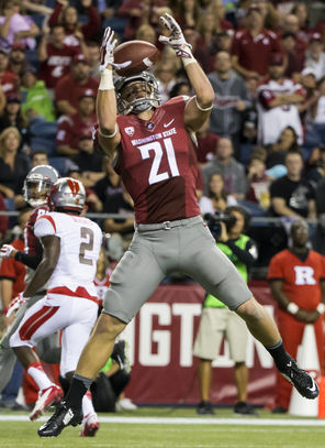 Washington State receiver River Cracraft catches a touchdown pass, but later had a crucial fumble that led to Rutgers' winning score.