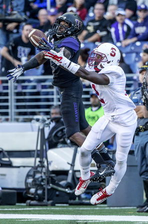 Kasen Williams, left, comes down with a one-handed catch against Stanford's Wayne Lyons for his only reception of the game. The 14-yard gain came in the first quarter.