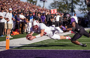 Stanford quarterback Kevin Hogan dives for  the corner of the end zone past UW's Cory Littleton to score the winning touchdown on a 5-yard run with 4½ minutes left to play.